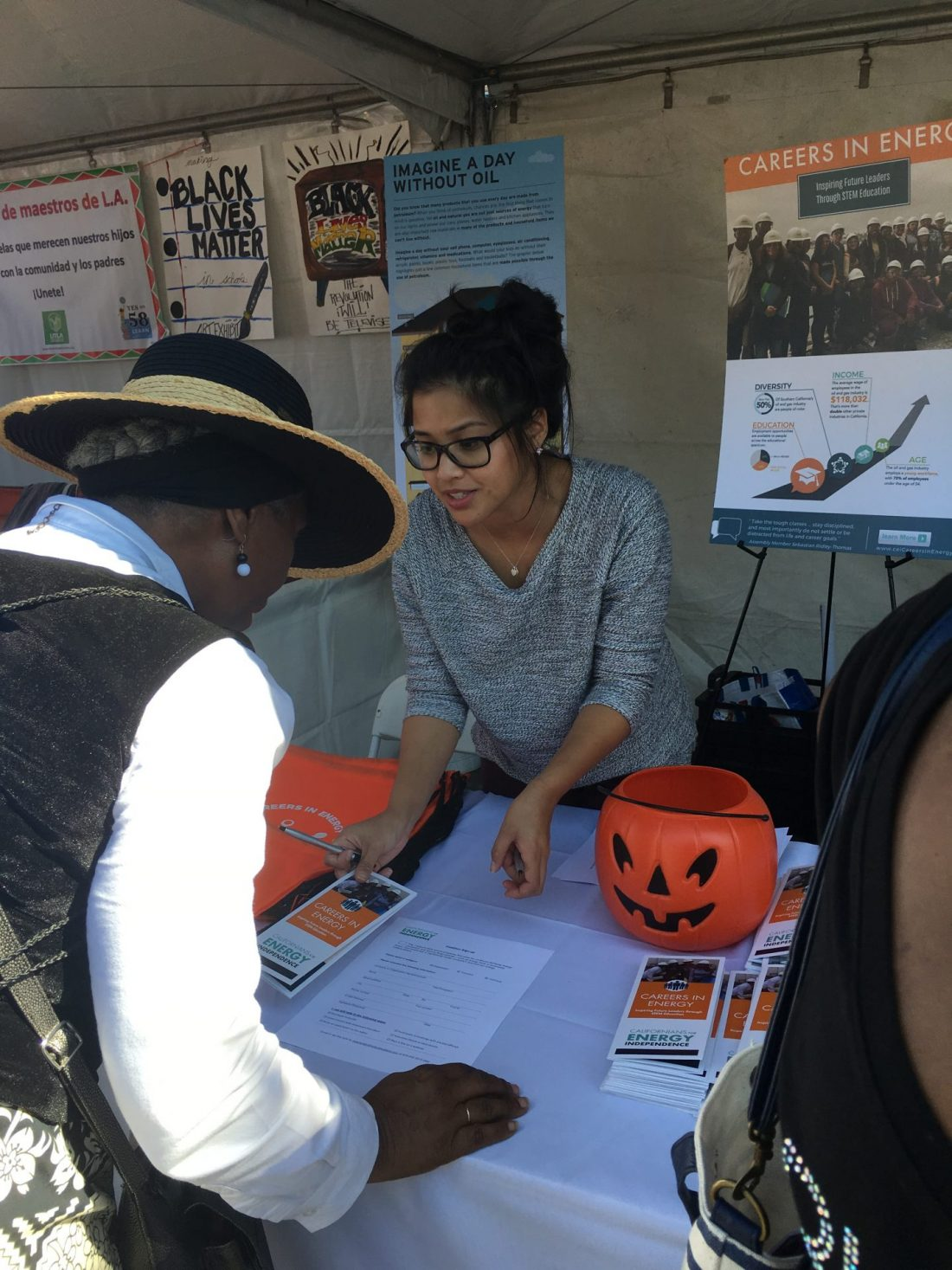 CEI volunteers handing out pamphlets at the Taste of Soul's annual street festival.