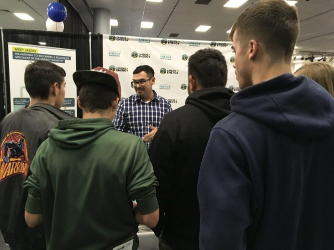 CEI volunteer speaks to students at the Careers in Energy booth at the Fresno County Superintendent of Schools' Annual Career Tech Expo.