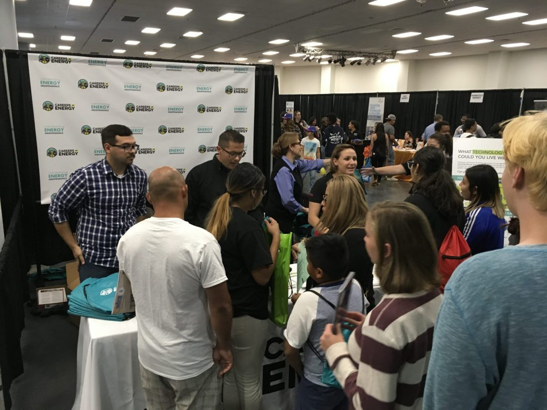 CEI team members helping students at the Careers in Energy booth at the Fresno County Superintendent of Schools' Annual Career Tech Expo.