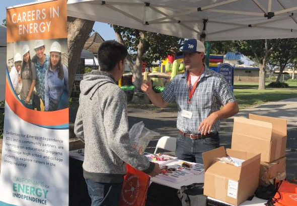 Careers in Energy volunteers talking with a student at the Santa Maria Expofest.